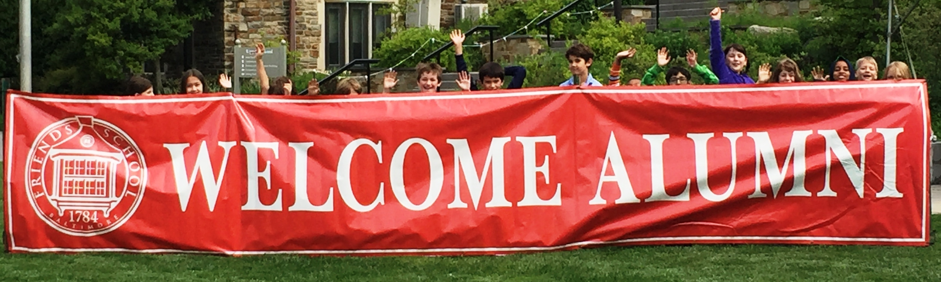 Welcome Alumni banner with kids